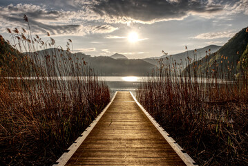 Fototapeta Jetty into Lake Lugano at sunrise
