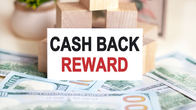 On the table are dollars and a sign on which it is written - cash back reward. Finance and economics concept.