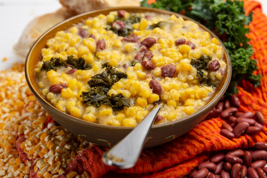 Cachupa, A hearty vegan delicious Cape Verdean stew packed with fresh, flavor veggies, traditional hominy corn soup or stew and Portuguese bread