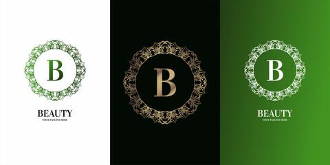 Fototapeta Letter B initial alphabet with luxury ornament floral frame logo template.
