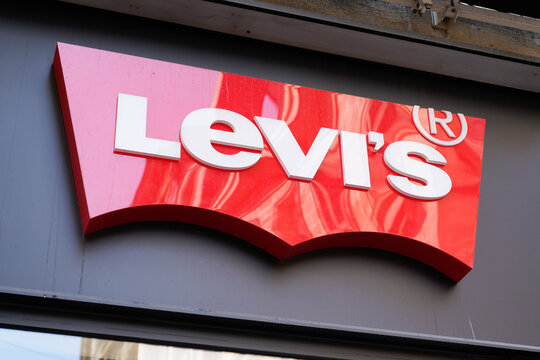 Levis clothing store brand text and shop logo sign Levi's in street
