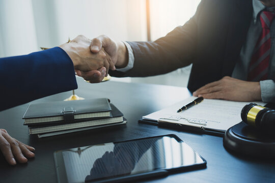 Two businessmen are shaking hands to congratulate a contract