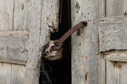 rusty door lock on a wooden door