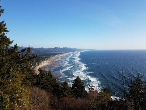 ocean shore and waves on coast in Manzanita, Oregon