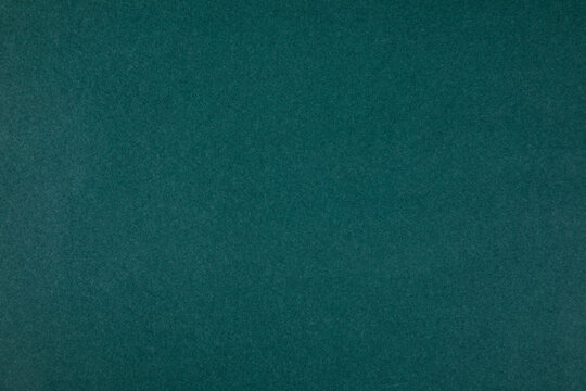 Abstract photo of a rough texture in dark marine green color - perfect for background