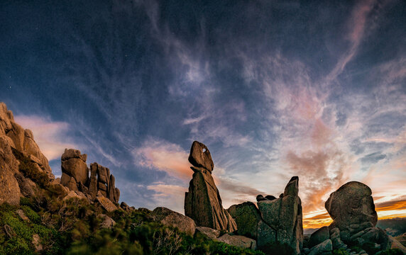 Mesmerizing view of rock formations in the Pedriza Natural Park in Madrid, Spain under a wispy sky