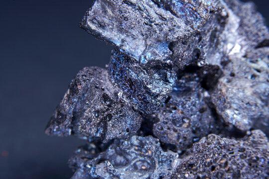 Macro shot of a Magnetite mineral specimen on a blurred background