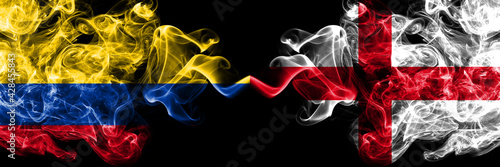 Colombia, Colombian vs England, English smoky mystic flags placed side by side. Thick colored silky abstract smokes flags.