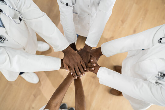 African American Medical Team Hands Stack