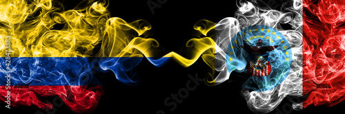 Colombia, Colombian vs United States of America, America, US, USA, American, Columbus, Ohio smoky mystic flags placed side by side. Thick colored silky abstract smokes flags.