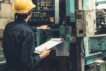 Skillful factory worker working with clipboard to do job procedure checklist . Factory production line occupation quality control concept .
