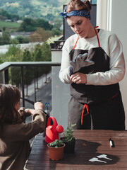 Obraz preparing the garden at home as a family. planting aromatic plants - fototapety do salonu