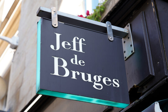 jeff de bruges logo brand and text sign of bakery chocolaterie storefront from Belgium