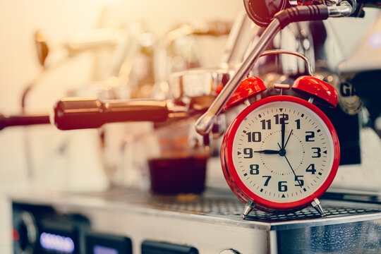 Brew time, Alarm clock with espresso machine for making coffee timing concept