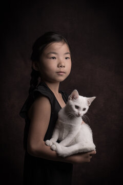 Classic painterly portrait of a little girl in black  with a white cat