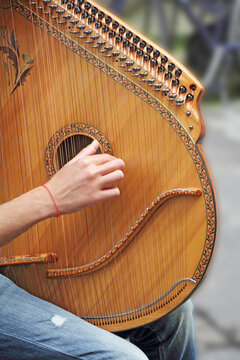 Man playing medieval lute on the street