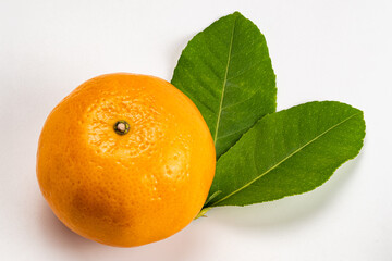 Fototapete - High angle view of single mandarin orange with leaves on white background with clipping path. It is one of the most popular fruit of summer season in Thailand.