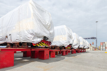 New diesel-electric locomotive awaits delivery at the deep sea port.