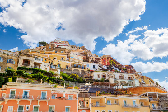 View over the town of Positano on the Amalfi Coast, Italy. Blue sky with clouds