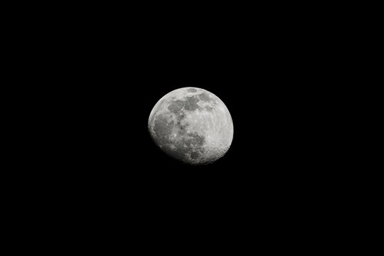 Moon isolated on black background. Waxing gibbous phase, a few days before the full moon