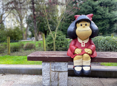 Oviedo, Spain - January 3, 2021: Statue of Mafalda character in Oviedo, Spain. It is a tribute to Quino and it is located at San Francisco park.