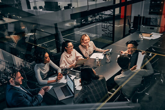 Young successful business team working in a spacious beautiful office communicating and discussing work. Concept of business, finance, strategy, management, advertising, planning.