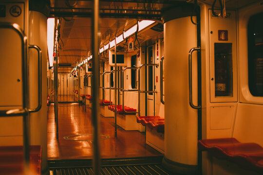 Shallow focus inside the empty metro illuminated with dim lights