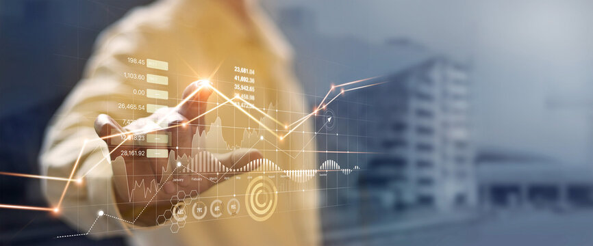 Businessman hand touching and analysing banking and investment growth graph to develop smart financial decision for business plan strategy in expand business and increase sale profit.