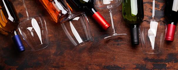 Fototapeta Various wine bottles and glasses