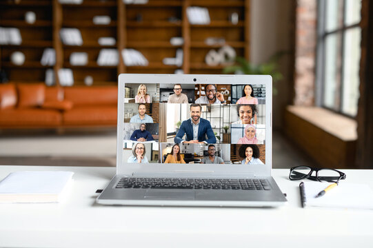 Laptop screen webcam view different ethnicity age people engaged in group videocall. Video conference lead by european businessman leader. Modern technology, easy convenient on-line meeting concept