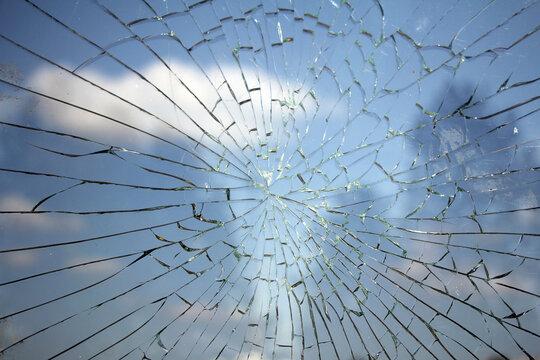 Glass broken cracks splinters in front of the bus station