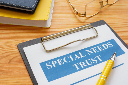 Special needs trust application with clipboard and notepad.