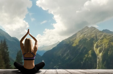 Young woman practicing yoga in the nature. female happiness. Landscape background