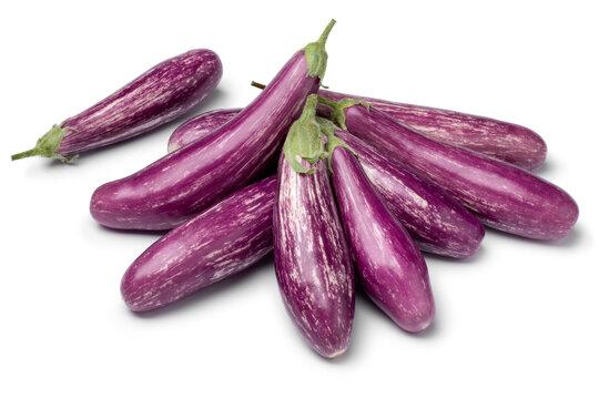 Heap of fresh raw organic purple mini eggplants isolated on white background