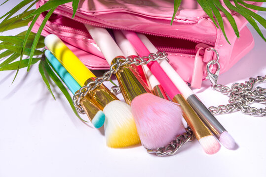 Set of professional colorful makeup brushes in cosmetic bag holder, closeup