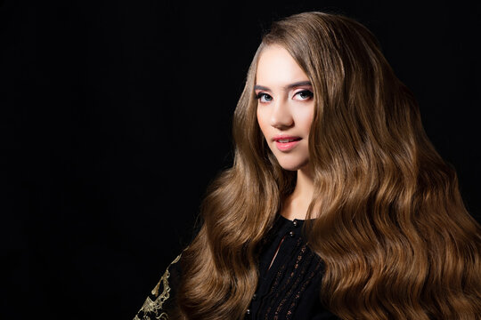 Luxurious golden curls, portrait of a young beautiful woman with beautiful hair,