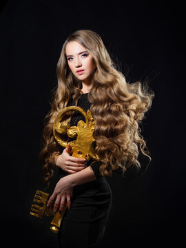 key to hair beauty, a glamorous concept. A young beautiful blonde woman
