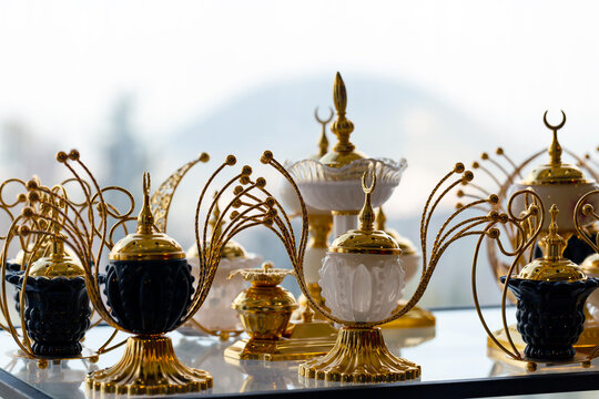 Table lamp with golden decoration. Mosques dome and crescent moon, symbol islamic religion and free space background well for text arabic present. Blurred background, selective focus