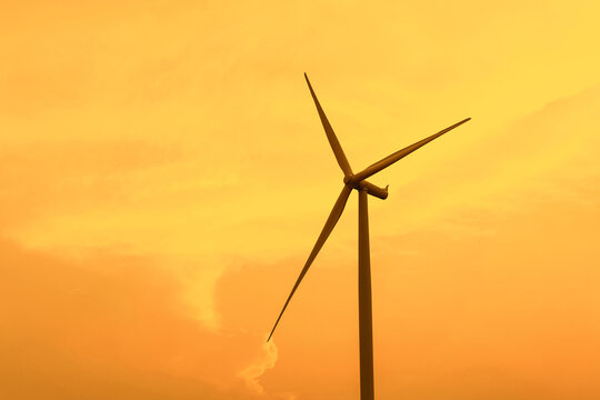 Wind turbine renewable energy source summer in forest mountains landscape energy transmission distribution equipment in natural environment