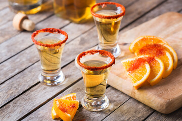 Mexican mezcal or mescal shot with chili pepper and orange