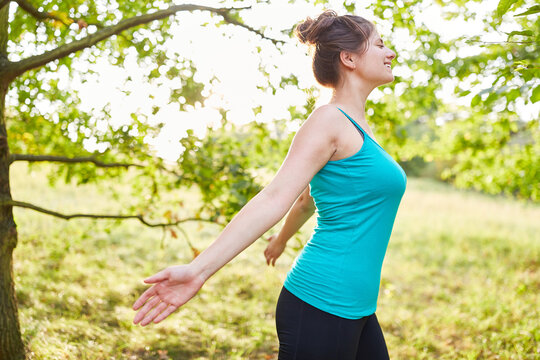 Woman breathes fresh air during stress relief workout