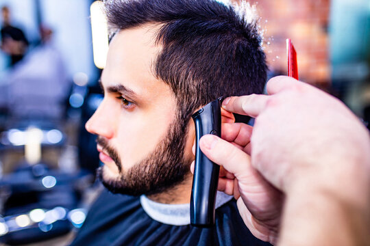 arabic handsome bearded man getting haircut at barbershop