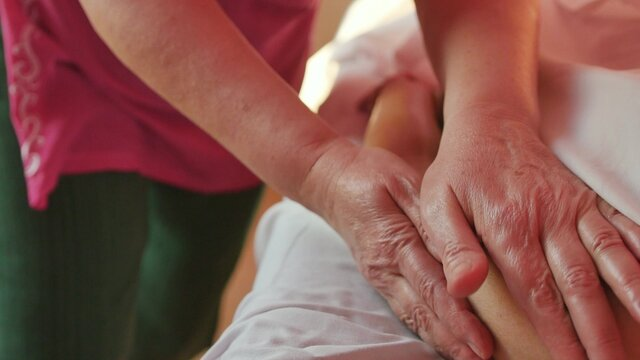 Hand massage procedure in the spa salon. Massage your fingers and wrist at the spa