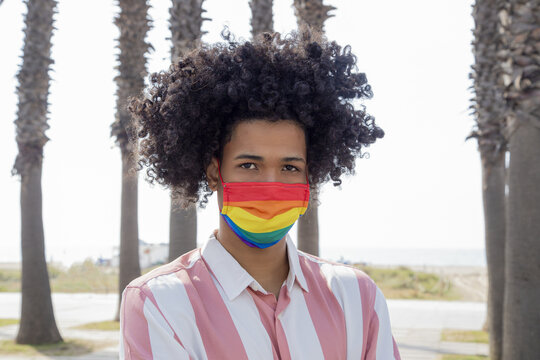 Portrait of a young African man wearing pride mask - LGBT during the pandemic