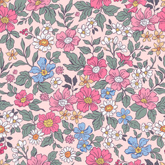 Vintage seamless floral pattern. Liberty style background of small pink and lilac flowers. Small flowers scattered over a pink background. Stock vector for printing on surfaces. Realistic flowers.