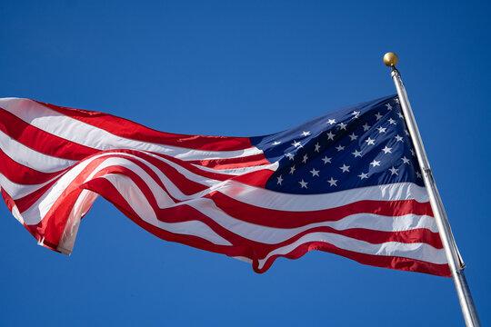 Waving flag of USA on blue background.