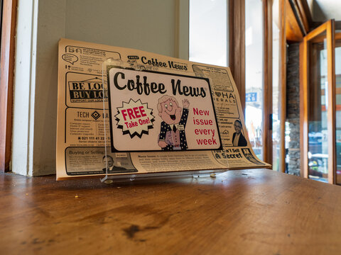 AUCKLAND, NEW ZEALAND - Apr 16, 2021: Coffee News advertising newspaper in local cafe