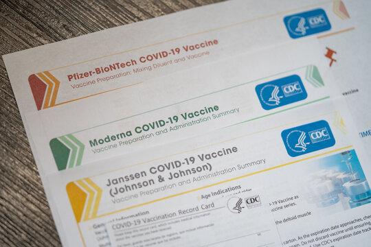 Washington, DC, USA - April, 1, 2021: Pfizer-BioNTech, Moderna, Janssen Johnson and Johnson Vaccines summary by CDC. Close up view.