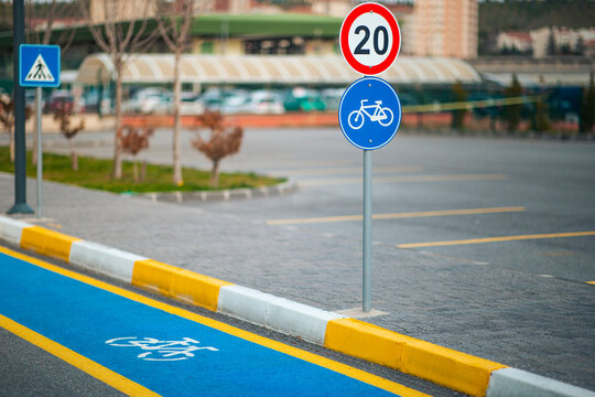 Empty blue bike road with bike and pedestrian sign