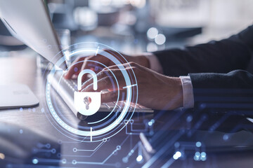 A programmer is typing a code on computer to protect a cyber security from hacker attacks and save clients confidential data. Padlock Hologram icons over the typing hands. Formal wear. - fototapety na wymiar
